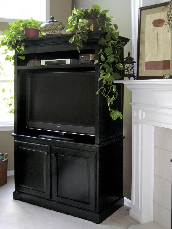 Black distressed TV cabinet.