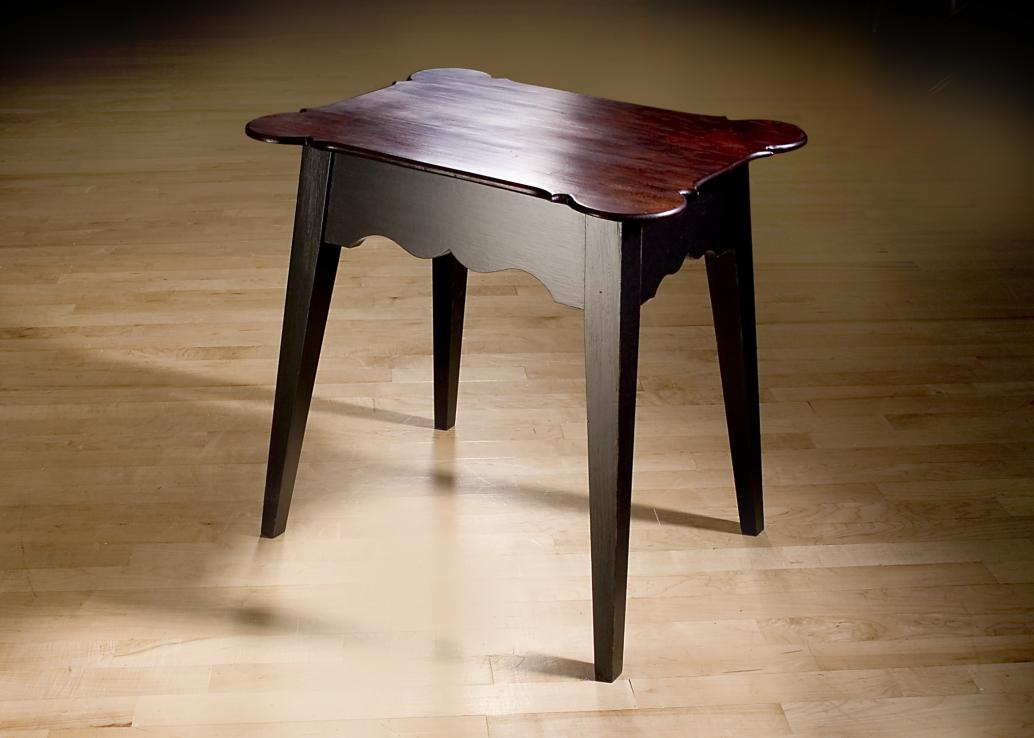 Side table with tapered legs and solid cherry porringer top.