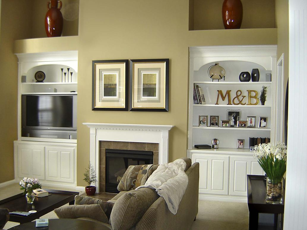 White painted bookcases built in to existing space.