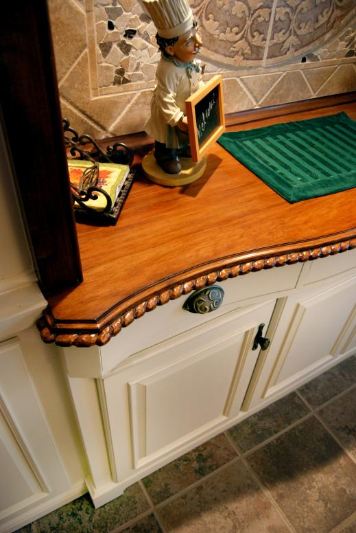 Handcarved detail rope edging on dining room buffet top.