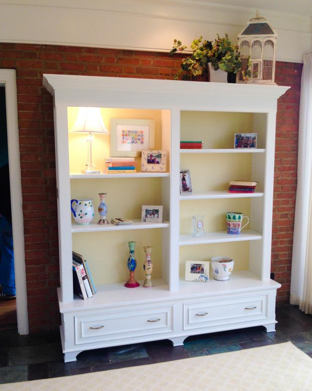 Freestanding solid wood bookshelf with painted finish.