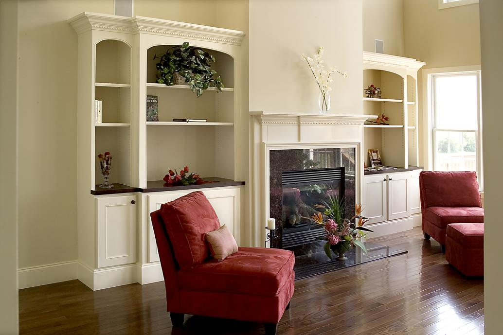 Built in painted bookcases with wood stained counters and coordinating mantle.