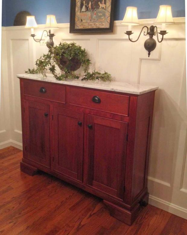 Solid cherry buffet with marble top.