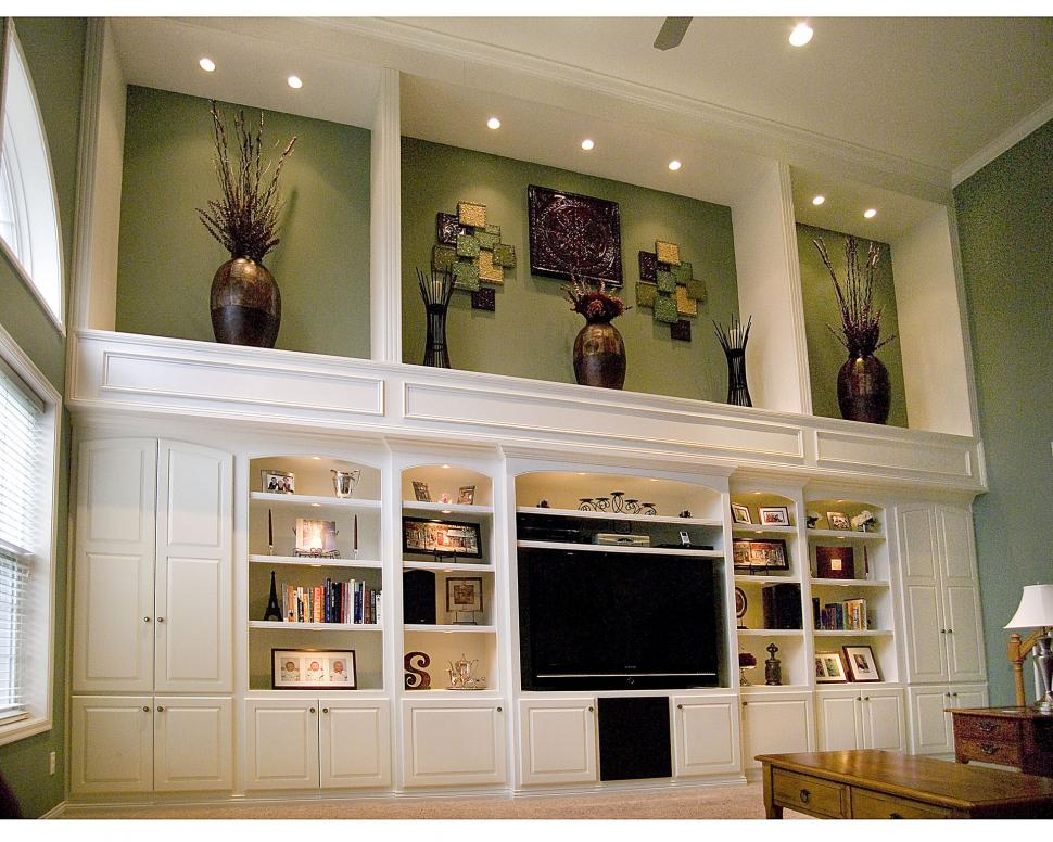 Floor to ceiling entertainment center stretching along a 24 foot wall with shadow boxes above to complement base.