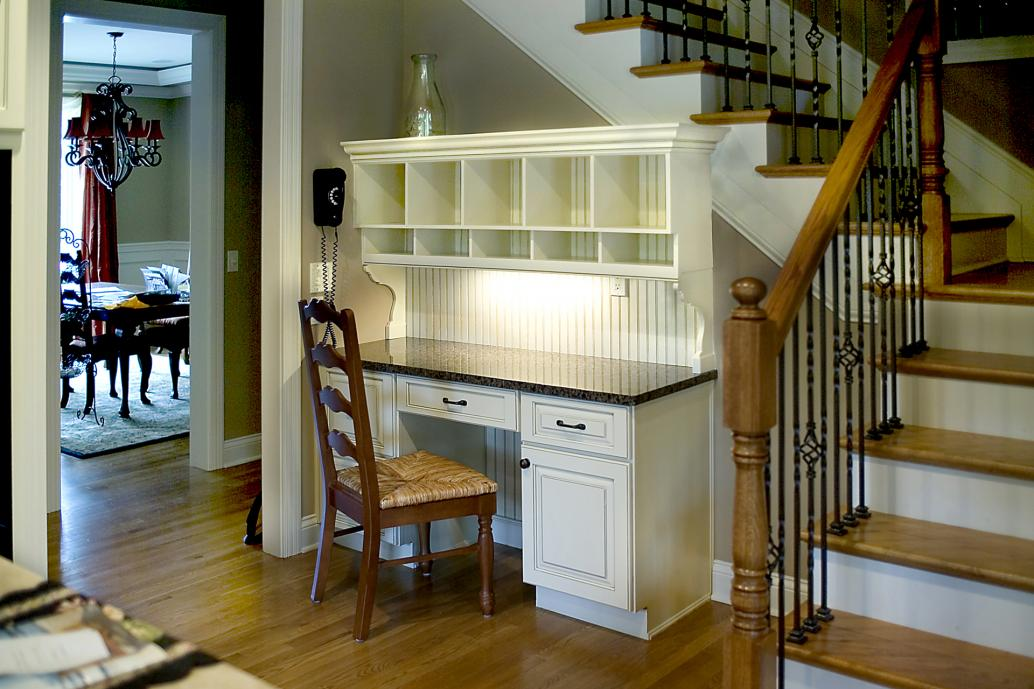 Custom hutch to fit over and match existing planning desk. Finished in white with glazed top coat.