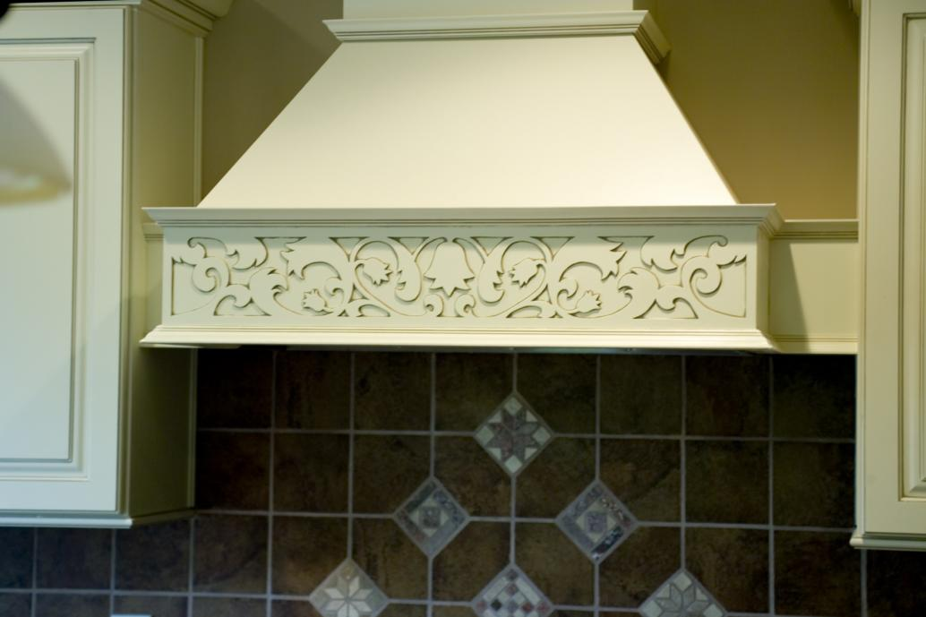 Custom made oven hood with hand-carved detail.