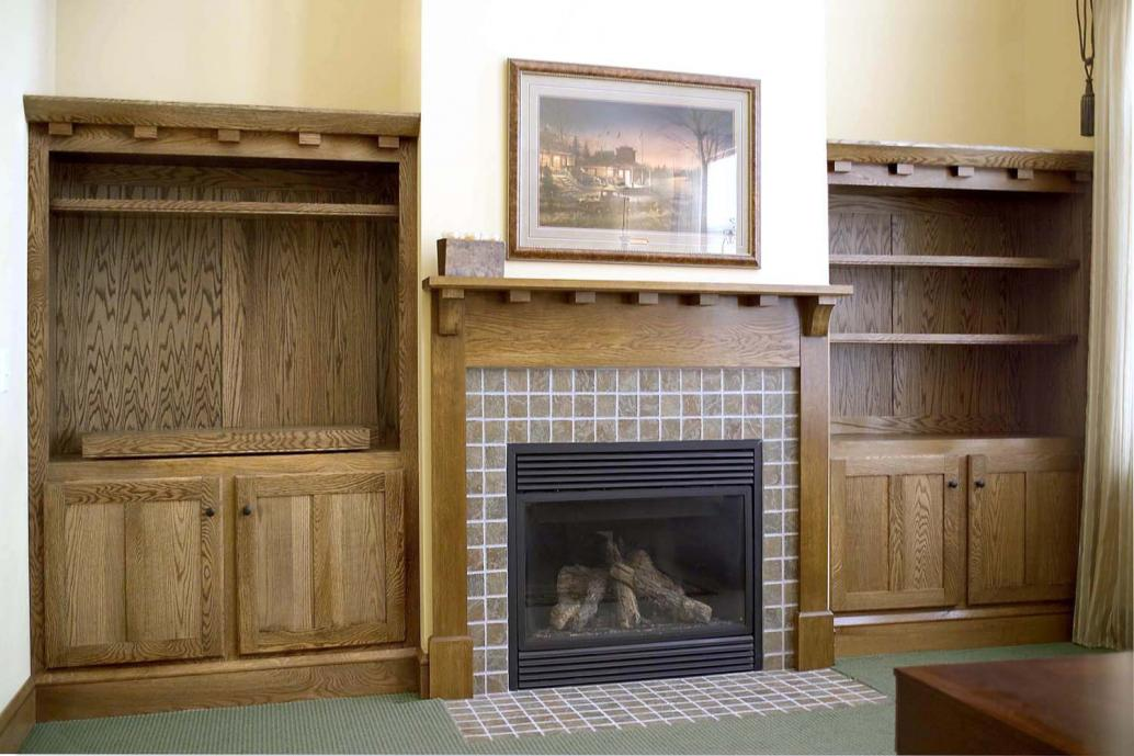 Solid white oak craftsman style built in bookshelves and mantle and fireplace surround.