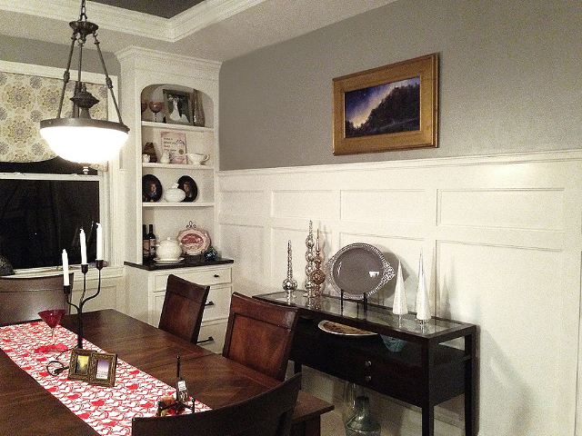 Dining room wainscoting and a pair of corner cabinets .